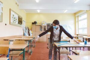 Teacher marking desks in the classroom